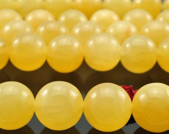 37 pcs of Natural Yellow Jade smooth round beads in 10mm