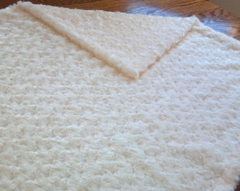 """A furry """"poodle"""" blanket."""