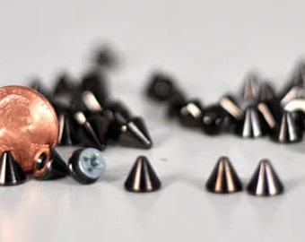7mm black screwback cone spikes. Bag of 20. Leathercraft or glue-on StudsAndSpikes