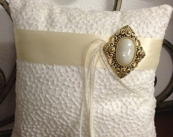 Vintage Ring Bearer pillow with white beading and ivory belt with broach