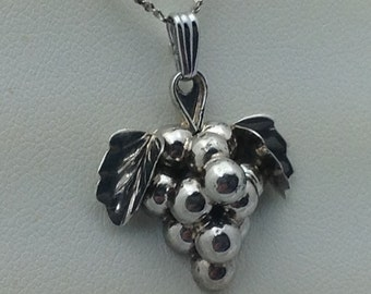 Sterling silver grape cluster pendant.