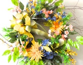 Springtime colors ...blue hydrangea, yellow spider mum and daisies, olive green lilies...beautiful door wreath