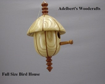 "This beautiful lathe turned segmented bird house is made of Mahogany & Ash.It's 10 1/2"" tall x 6"" in dia."