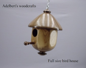 This  lathe turned bird house is made of Black Walnut & Butternut.
