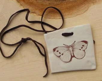 Butterfly, porcelain necklace on a leather thong
