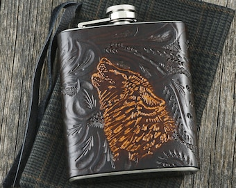 Leather flask handtooled with a wolf drawing handengraved
