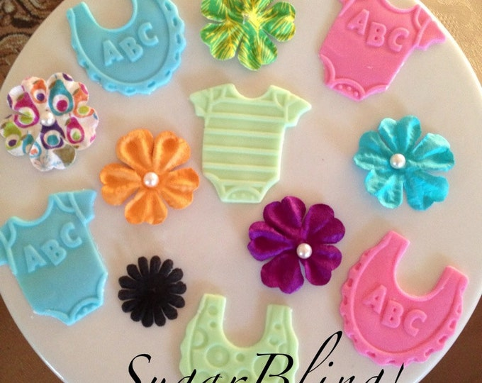One Dozen Fondant onesies and bib Cupcake toppers! Perfect for a baby shower! Plz state your color and dated needed by during purchase.