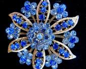 Stunning blue rhinestone brooch is also a pendant