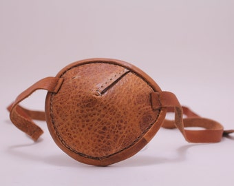 Brown leather eye patch