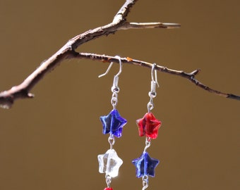Star red clear and blue glass earrings