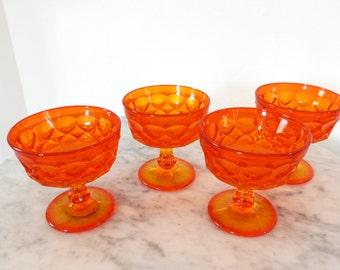 Set of four vintage stemmed glass bowls