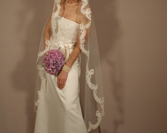 "Mantilla wedding veil oval cut 65"" long waltz length."