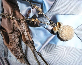 Petrified sandball put in silver with silver chain and pearls in earth tones.