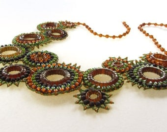 Brown and Green Bib-Style Efflorescence Necklace with Hand-Carved Horn Rings