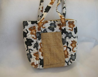 Kitty Print Petite Bag,  with padded handles, 2 outside pockets.