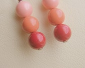 Swarovski Glass Pearls in colors of Peach, Coral, and Burnt Orange on Lead Free Copper plated earwires