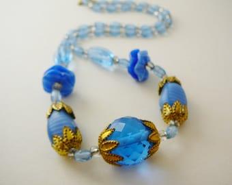 Vintage .. Czech Necklace Blue Sapphire Clear Glass Gold Tone Brass Flower Caps Spring