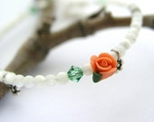 Reserved listing - Mother of pearl rose flower bracelet, Swarovski crystal, white, orange, green, sterling silver tint charm, spring wedding