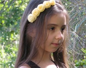 Floral headband with small roses in shades of creamy yellow, child size