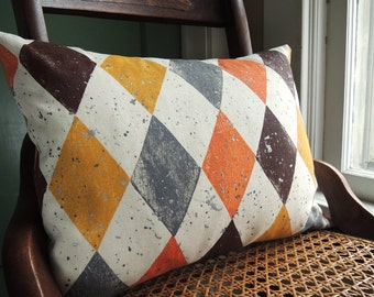 Oxblood yellow ochre orange harlequin spatter hand block printed linen home decor colorful decorative retro geometric modern pillow cover