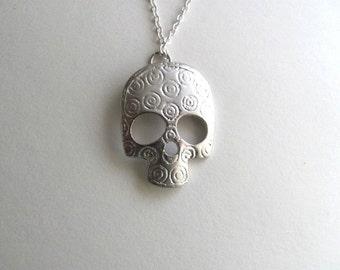 Silver decorative skull pendant necklace on delicate silver plated chain, satin finish