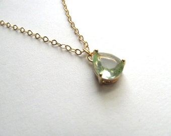 Simple green peridot necklace on 14k gold plated chain, tear drop pendant