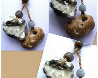 Pebble keyring with handwork glass beads.