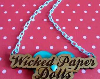 Baby-Blue Wicked Paper Dolls Cherry Wood Name Plate Pendant