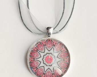The Pink Bicycle: a fractal photo mounted under a glass, set in a round silver pendant and hung on an organza ribbon necklace