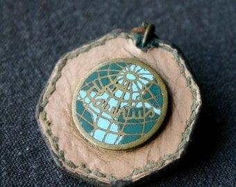The world in your pocket. Vintage souvenir globe pendant.