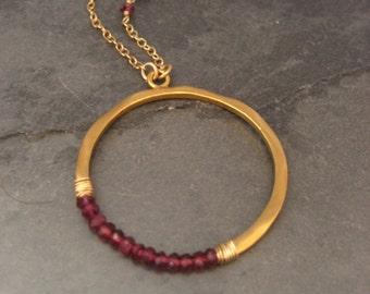 Rhodolite garnet crescent necklace
