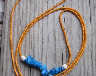 long beaded necklace orange czech seed beads with blue stones