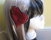 Large stitched heart with zipper trim and safety pins hair clip