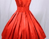 A 50s style Red Shantung cocktail dress, fully lined and shown wearing a petticoat