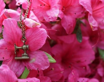"Handmade vintage bronze necklace with sewing machine charm on an 18"" chain"