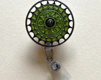 Green and metal badge reel cover