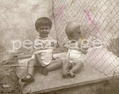 Rare babies in a rare place. Very old real photo. Extrange feet malformation