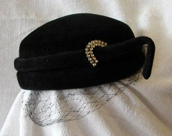Black velour hat with rhinestone accent