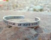 Cuff Bracelet, Real or Not Real, Hunger Games, Hand stamped bracelet