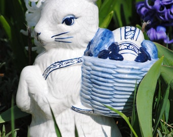 "A captivating 12.5"" high ceramic Peter Rabbit on his delivery route laden with Easter goodies from The Potting Shed of Saxonville, Ma."
