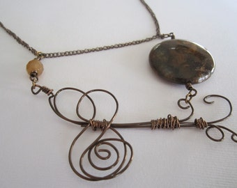 Swirls necklace with golden turquoise
