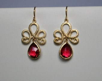 Lotus swirl earrings with ruby drops