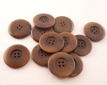 BUTTONS: Vintage vegetable ivory buttons, rusty brown, 4 holes, 1 1/4 inch.  Set of 12 buttons.