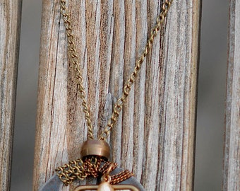 Necklace with vintage brass tool tag and neuron charm