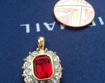 Gold Tone Red Faceted Glass and Clear Rhinestone Pendant