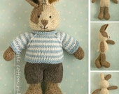 Knitted Toy knitting pattern for a bunny rabbit with a piebald patch, shorts and a stripy sweater