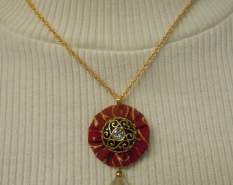 Burgundy Color Fabric and Crystal Swirl Button Pendant Necklace