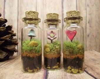 Sweet Set of Three bottle Terrariums With Raku Fired Heart Flower and Glow in the Dark fairy Mushroom Handmade by Gypsy Raku