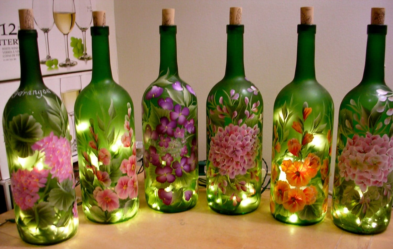 Hand painted lighted wine bottle floral designs for Hand painted glass bottles