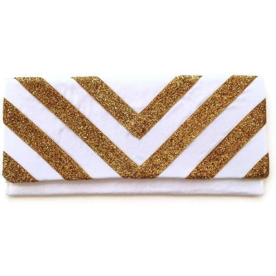 The Glitter Chevron clutch in gold and white